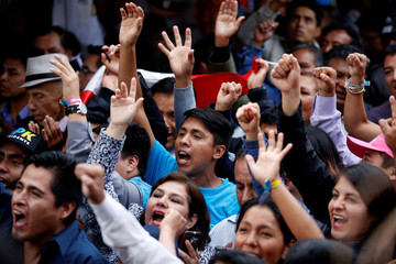 Peruvian presidential candidate Pedro Pablo Kuczynski's supporters celebrate after Peru's electoral office ONPE said that he won more votes than Keiko Fujimori in the country's presidential election in his headquarters in Lima