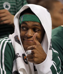 Boston Celtics guard Rondo gives a thumbs up to teammate Daniels during their NBA basketball game against New York Knicks in Boston