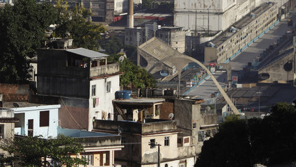 Rio de Janeiro's sambadrome is seen behind the Querozene slum during an operation against drug dealers