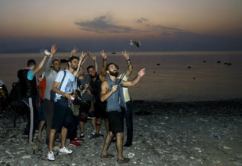 Syrian refugees arrive on the Greek island of Kos in Greece