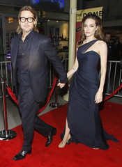 "Jolie and her partner rad Pitt arrive at the premiere of ""In the Land of Blood and Honey"" in Los Angeles"