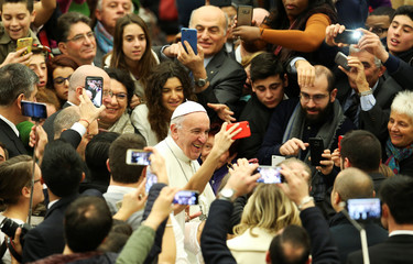 Pope Francis arrives to lead his Wednesday general audience in Paul VI hall at the Vatican