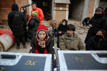 The Wider Image: Beijing's walking dead on the loose