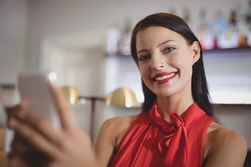 Portrait of beautiful woman using mobile phone