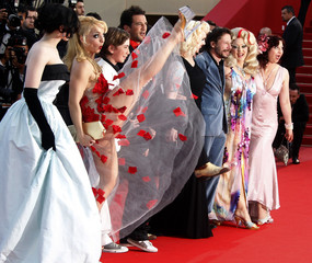 """Director Amalric and cast members arrive for the screening of the film """"Tournee"""" at the 63rd Cannes Film Festival"""