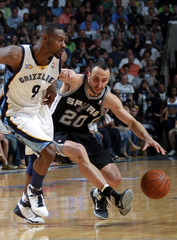 Memphis Grizzlies guard Allen defends San Antonio Spurs guard Ginobili in Memphis, Tennessee