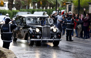 Britain's Queen Elizabeth and Prince Philip arrive for a state visit and to attend the Commonwealth Heads of Government Meeting in Valletta