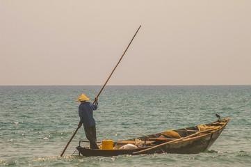 Traditional Vietnamese fishing along the beautiful coastline of Vietnam