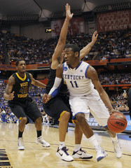 Kentucky's Wall goes to the basket against West Virginia's Mazzulla during their NCAA East Regional college basketball game in Syracuse