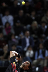 Djokovic of Serbia serves to Murray of Britain during their semi-final match at the Rome Masters tennis tournament