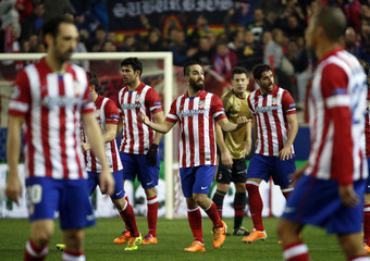 Atletico Madrid's Arda Turan celebrates his goal against AC Milan with teammates during their Champions League last 16 second leg soccer match at Vicente Calderon stadium in Madrid