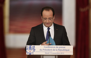 France's President Hollande arrives for a news conference at the Elysee Palace in Paris