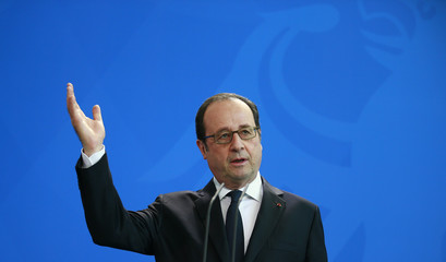 French President Hollande address the media at the Chancellery in Berlin