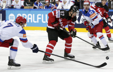 Russia's Kulikov challenges Canada's Crosby during their Ice Hockey World Championship final game at the O2 arena in Prague