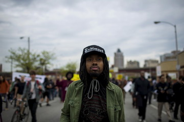 Demonstrators march in Baltimore, Maryland