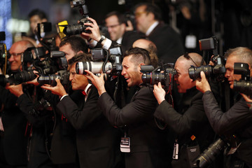 """Photographers work as guests arrive on the red carpet for the screening of the film """"The Lobster"""" in competition during the 68th Cannes Film Festival in Cannes,"""