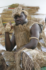 A model dressed in traditional clothes made with raffia, a natural fibre drawn from a palm tree, poses during a fashion show organized by Ivorian designer Genevieve Koukougnon, in Abidjan