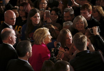 Democratic U.S. presidential candidate Hillary Clinton takes photos with supporters following the Hard Hats for Hillary event at the Danceland Ballroom in Davenport, Iowa