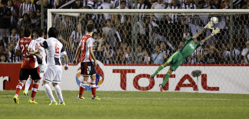 Vargas of Libertad scores against River Plate in Asuncion
