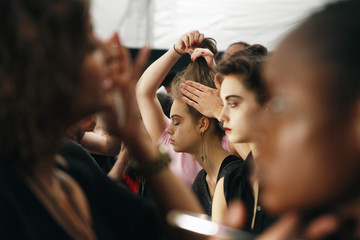 Models have their make up applied backstage before a presentation of the Lela Rose Fall/Winter 2012 collection during New York Fashion Week