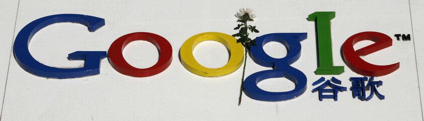 A flower is seen on the company's logo outside Google China's headquarters in Beijing