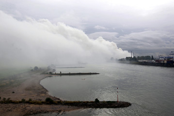 Plumes of smoke billow into sky above Rhine river following fire at fertiliser plant in Krefel