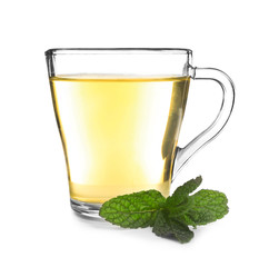 Cup of tea with mint leaves on white background