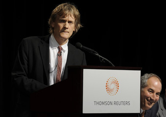 Thomson Reuters Chairman Thomson speaks as CEO Glocer  looks on at their Annual Meeting of Shareholders in Toronto
