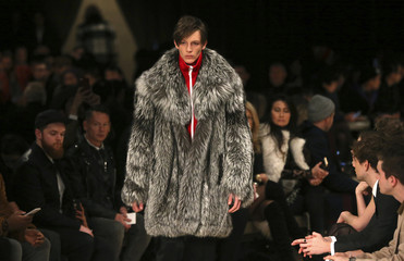 """A model presents a creation from the Burberry catwalk show at the """"London Collections: Men"""" Autumn/Winter 16 in London"""