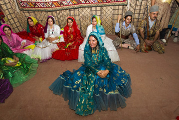 Iranian Ghashghai people wait to perform at symbolic traditional wedding ceremony during nomadic pastoralist festival in northern Tehran