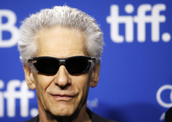"Cronenberg poses before news conference for ""The Cronenberg Project"" at the 38th Toronto International Film Festival"