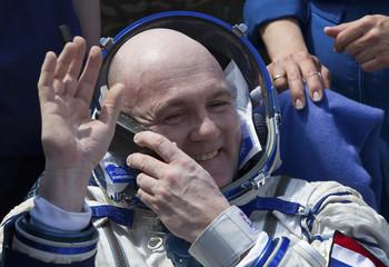ISS crew member Kuipers waves after the landing of Soyuz TMA-03M capsule near Zhezkazgan