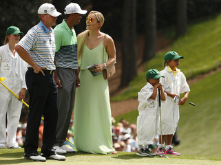 U.S. golfer Stricker  stands on the first green with compatriot Woods and Woods' girlfriend Vonn and his two children during the par 3 event held ahead of the 2015 Masters at Augusta National Golf Course in Augusta