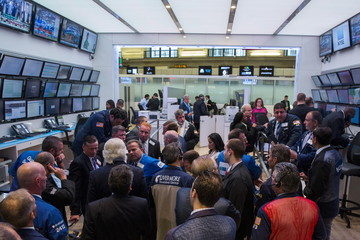 Traders, governors, and members of the New York Stock Exchange discuss what is happening following a halt in trading on the floor of the exchange in New York