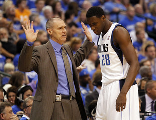 Dallas Mavericks coach Carlisle talks to Mahinmi during their NBA Western Conference quarter-final playoff basketball game against the Oklahoma City Thunder in Dallas