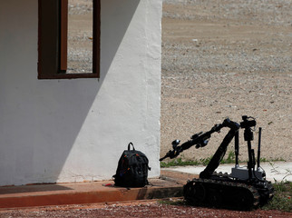 A Remotely Operated Vehicle checks a bag for explosives during an ASEAN Defence Ministers' Meeting (ADMM)-Plus counter-terrorism exercise in Singapore