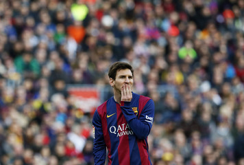 Barcelona's Messi gestures during the Spanish First division soccer match against Malaga at Camp Nou stadium in Barcelona