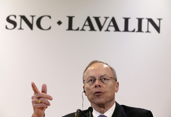 Robert G. Card, president and chief executive officer of SNC-Lavalin, gestures as he addresses the media following their AGM in Montreal