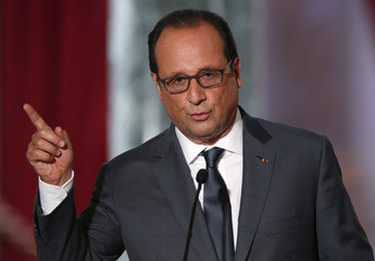 French President Francois Hollande attends his news conference at the Elysee Palace in Paris