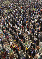 Shi'ite Muslims attend Friday prayers in Baghdad's Sadr City, northeastern Baghdad