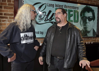 """Ive talks with Mendoza of the band """"Twisted Sister"""" after a ceremony at a local restaurant to pay tribute to musician and Rock and Roll Hall of Famer Lou Reed, in Freeport"""