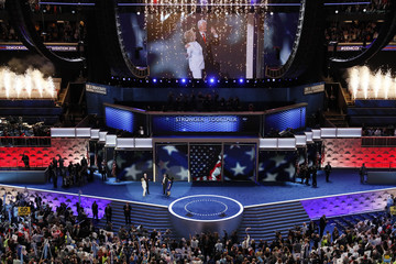 Hillary Clinton stands with her husband Bill Clinton at the Democratic National Convention in Philadelphia