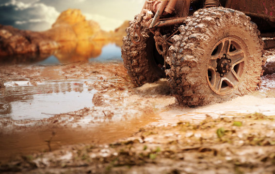 Off road vehicle coming out of a mud hole hazard,Travel and racing concept for four wheel drive off road vehicle .