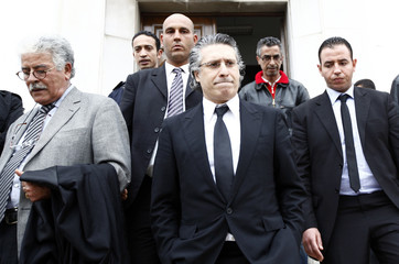 Nabil Karoui, the head of Tunisian station Nessma TV, leaves court in Tunis