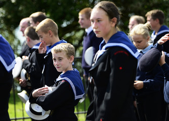 """Members of the Sea Cadets Corps take a moment's rest as they take part in a """"Short Step"""" ceremony, to mark the 100th anniversary of the outbreak of World War One (WW1) in Folkestone"""