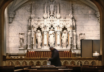 A man walks through St. Patrick's Cathedral during mass in New York