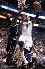 Utah Jazz guard Foye attempts a shot while defended by Oklahoma City Thunder forward Ibaka during their NBA basketball game in Salt Lake City