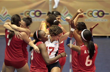 Costa Rican players celebrate after defeating Trinidad and Tobago in the women's volleyball third place match at the Central American and Caribbean games in Mayaguez