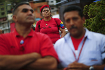 Supporters of late Venezuelan President Hugo Chavez stand outside his mausoleum to pay tribute to him in Caracas