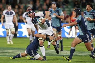 Campbell of Australia's Melbourne Rebels makes a break through New Zealand's Auckland Blues during their Super 15 rugby match